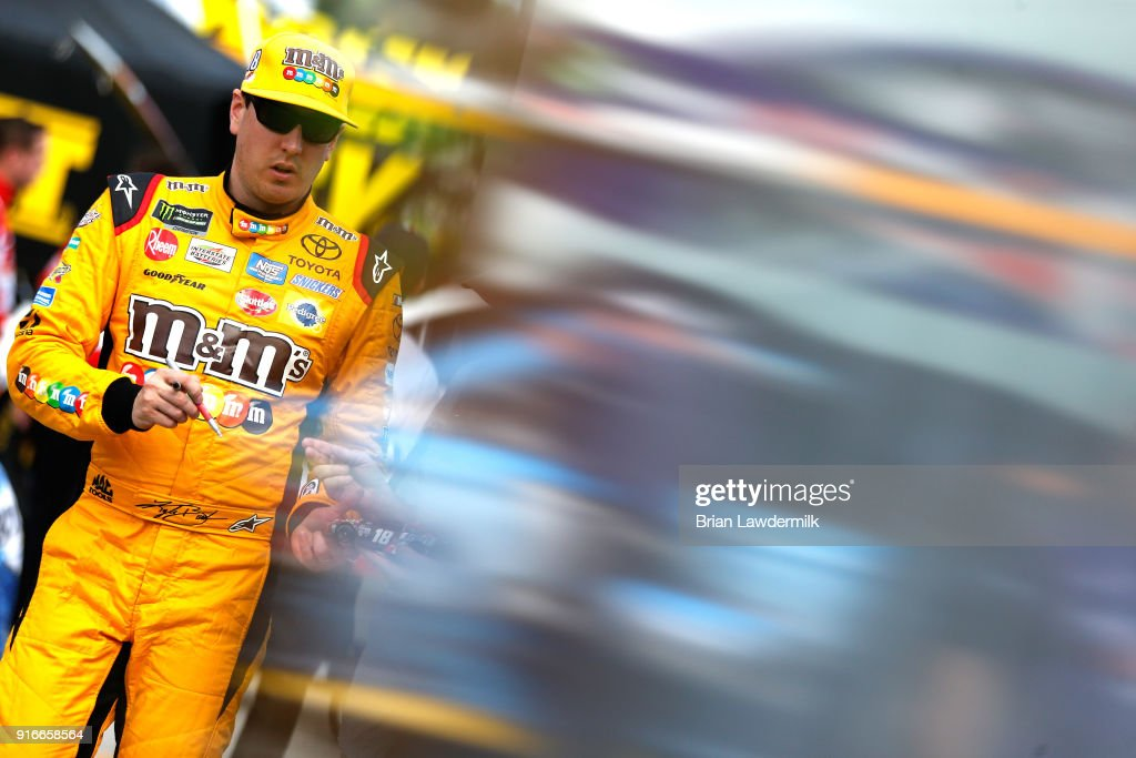 Kyle Busch, driver of the #18 M&M's Toyota, stands in the garage during practice for the Monster Energy NASCAR Cup Series Daytona 500 at Daytona International Speedway on February 10, 2018 in Daytona Beach, Florida.