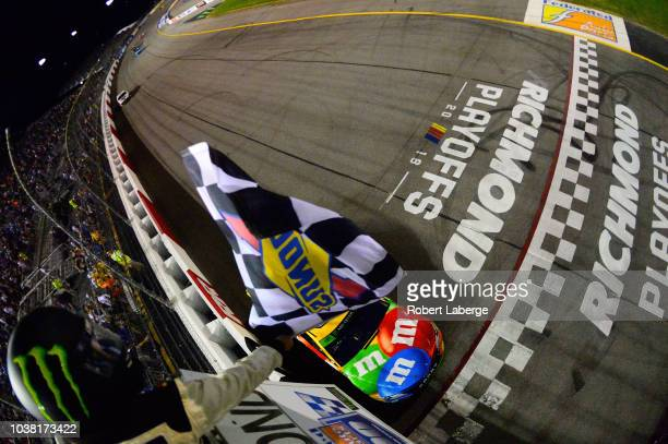Kyle Busch driver of the MM's Toyota takes the checkered flag to win the Monster Energy NASCAR Cup Series Federated Auto Parts 400 at Richmond...