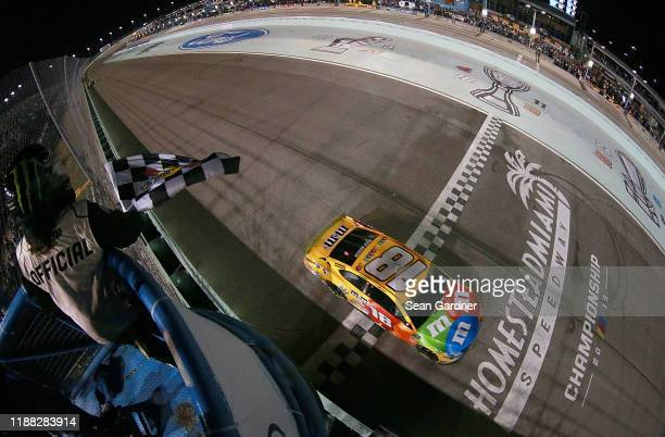 Kyle Busch driver of the MM's Toyota takes the checkered flag to win the Monster Energy NASCAR Cup Series Championship and the Monster Energy NASCAR...