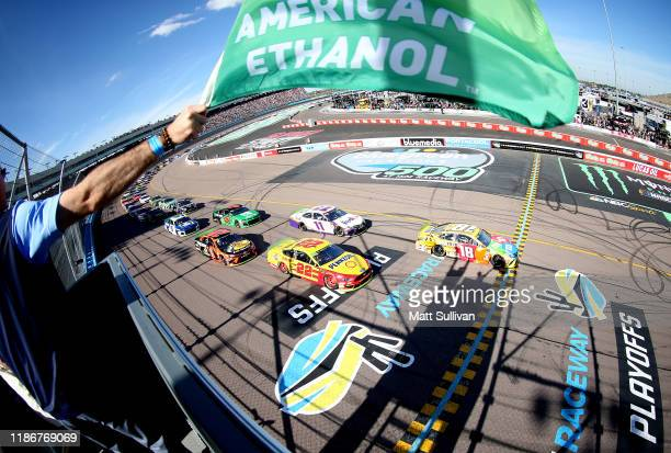 Kyle Busch, driver of the M&M's Toyota, takes the green flag to start the Monster Energy NASCAR Cup Series Bluegreen Vacations 500 at ISM Raceway on...