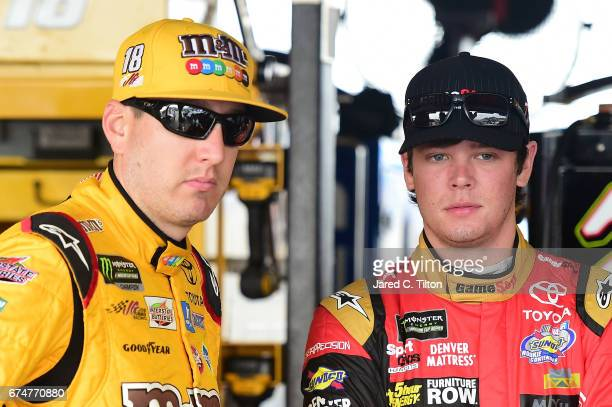 Kyle Busch driver of the MM's Toyota talks with Erik Jones driver of the GameStop/Prey Toyota during practice for the Monster Energy NASCAR Cup...