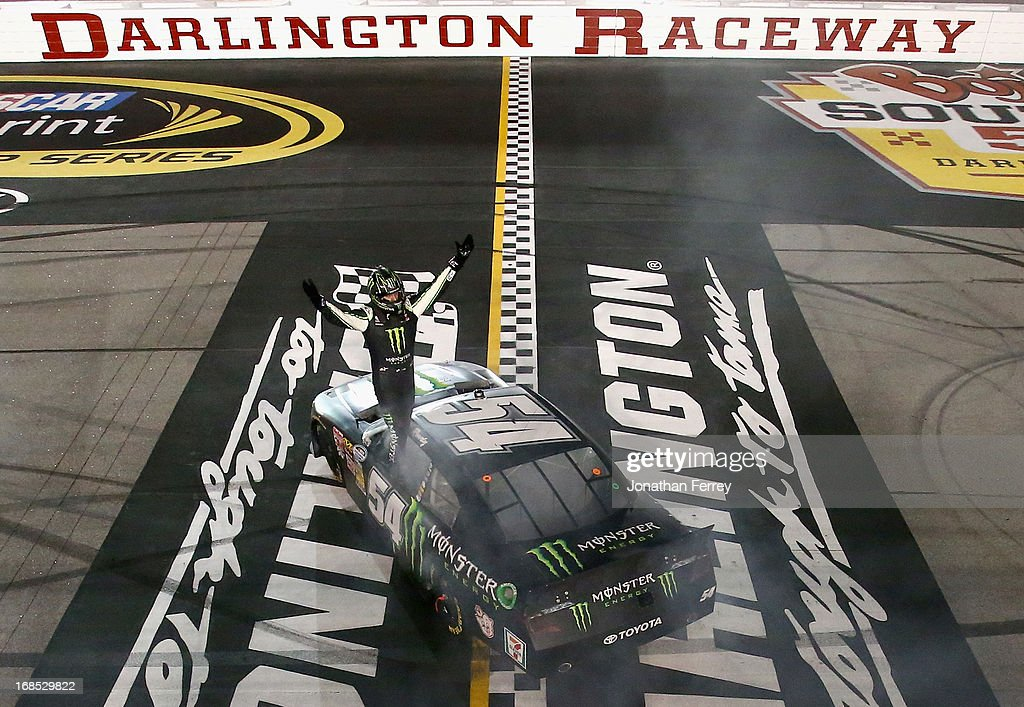 Kyle Busch, driver of the #54 Monster Energy Toyota, celebrates after performing a burnout following his win in the NASCAR Nationwide Series VFW Sport Clips Help A Hero 200 at Darlington Raceway on May 10, 2013 in Darlington, South Carolina.