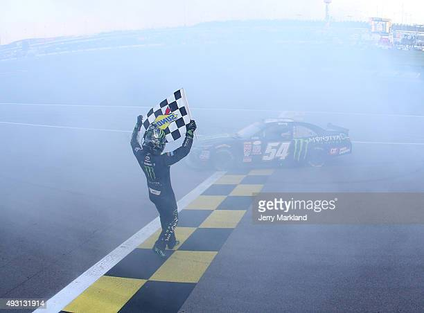 Kyle Busch, driver of the Monster Energy Toyota, celebrates after winning the NASCAR XFINITY Series Kansas Lottery 300 at Kansas Speedway on October...