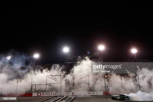 Kyle Busch driver of the Monster Energy Toyota celebrates by performing a burnout following his win in the NASCAR Nationwide Series VFW Sport Clips...