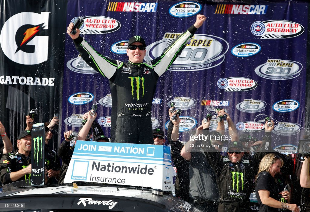 Kyle Busch, driver of the #54 Monster Energy Toyota, celebrates in victory lane after winning the NASCAR Nationwide Series Royal Purple 300 at Auto Club Speedway on March 23, 2013 in Fontana, California.