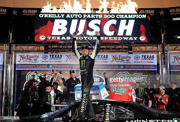 Kyle Busch, driver of the Monster Energy Toyota, celebrates in Victory Lane after winning the NASCAR Nationwide Series O'Reilly Auto Parts 300 at...