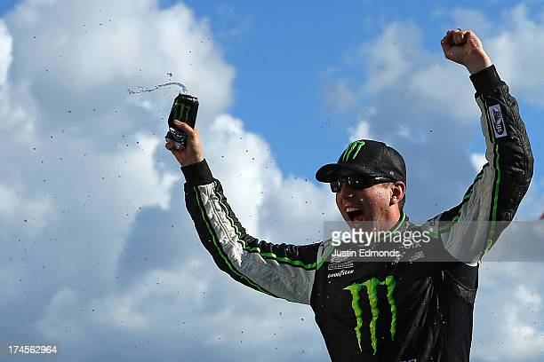 Kyle Busch driver of the Monster Energy Toyota celebrates in victory lane after winning the NASCAR Nationwide Series Indiana 250 at Indianapolis...