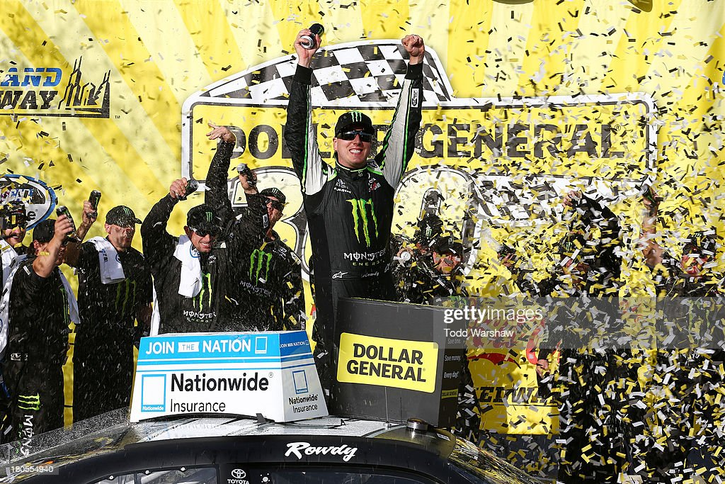 Kyle Busch, driver of the #54 Monster Energy Toyota, celebrates in victory lane after winning the NASCAR Nationwide Series Dollar General 300 Powered by Coca-Cola at Chicagoland Speedway on September 14, 2013 in Joliet, Illinois.