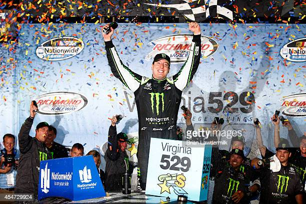 Kyle Busch driver of the Monster Energy Toyota celebrates in victory lane after winning the NASCAR Nationwide Series Virginia529 College Savings 250...