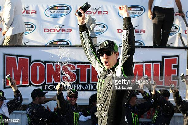 Kyle Busch driver of the Monster Energy Toyota celebrates in Victory Lane after winning the NASCAR Nationwide Series Dover 200 at Dover International...