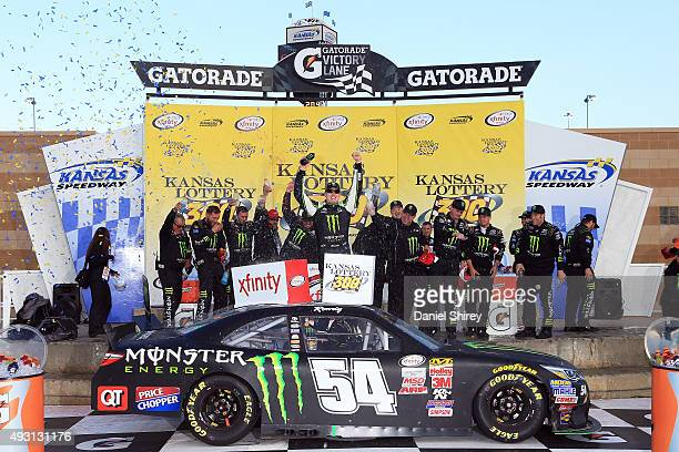 Kyle Busch driver of the Monster Energy Toyota celebrates in Victory Lane after winning the NASCAR XFINITY Series Kansas Lottery 300 at Kansas...