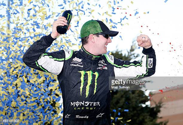 Kyle Busch, driver of the Monster Energy Toyota, celebrates in Victory Lane after winning the NASCAR XFINITY Series Kansas Lottery 300 at Kansas...