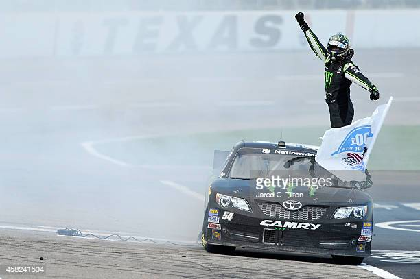 Kyle Busch, driver of the Monster Energy Toyota, celebrates winning the NASCAR Nationwide Series O'Reilly Auto Parts Challenge at Texas Motor...