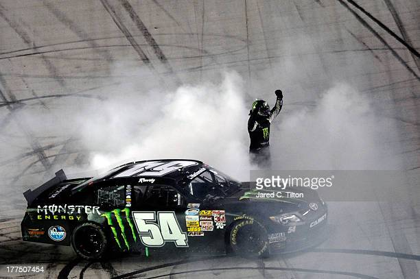 Kyle Busch, driver of the Monster Energy Toyota, celebrates with a burnout after winning during the NASCAR Nationwide Series Food City 250 at Bristol...