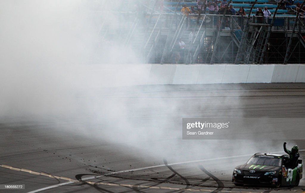 Kyle Busch, driver of the #54 Monster Energy Toyota, celebrates with a burnout after winning the NASCAR Nationwide Series Dollar General 300 Powered by Coca-Cola at Chicagoland Speedway on September 14, 2013 in Joliet, Illinois.