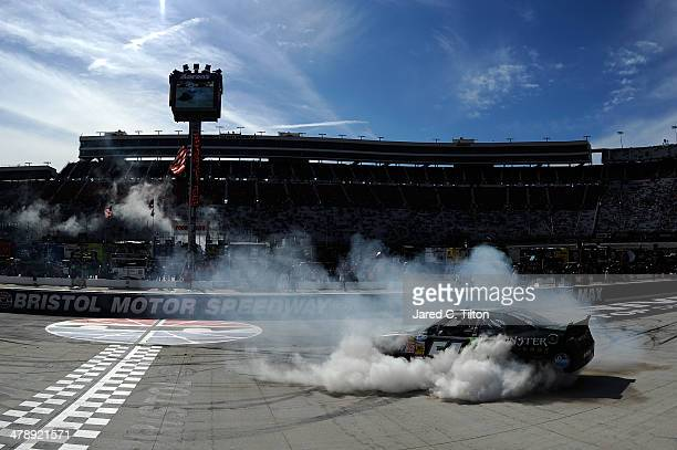 Kyle Busch driver of the Monster Energy Toyota celebrates with a burnout after winning the NASCAR Nationwide Series Drive To Stop Diabetes 300 at...