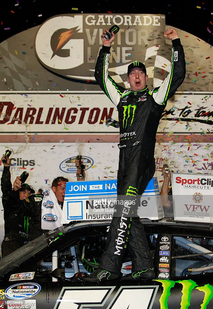 Kyle Busch, driver of the #54 Monster Energy Toyota, celebrates with his crew in victory lane after winning the NASCAR Nationwide Series VFW Sport Clips Help A Hero 200 at Darlington Raceway on May 10, 2013 in Darlington, South Carolina.