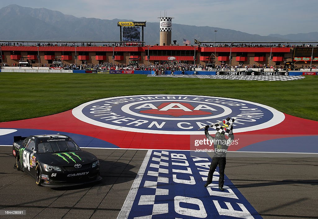 Kyle Busch, driver of the #54 Monster Energy Toyota, celebrates with the checkered flag after winning the NASCAR Nationwide Series Royal Purple 300 at Auto Club Speedway on March 23, 2013 in Fontana, California.
