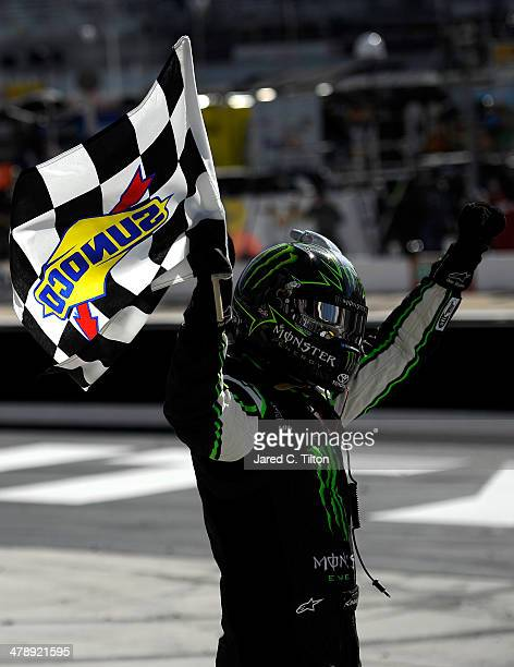 Kyle Busch driver of the Monster Energy Toyota celebrates with the checkered flag after winning the NASCAR Nationwide Series Drive To Stop Diabetes...