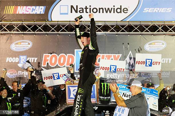 Kyle Busch driver of the Monster Energy Toyota celebrtates in Victory Lane after winning the NASCAR Nationwide Series Food City 250 at Bristol Motor...
