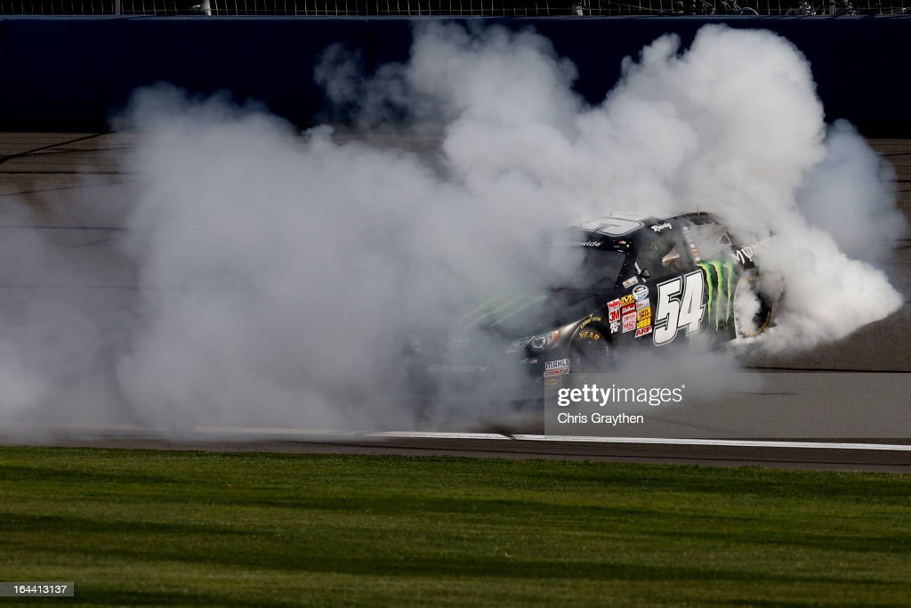 Kyle Busch, driver of the #54 Monster Energy Toyota, does a burnout after winning the NASCAR Nationwide Series Royal Purple 300 at Auto Club Speedway on March 23, 2013 in Fontana, California.