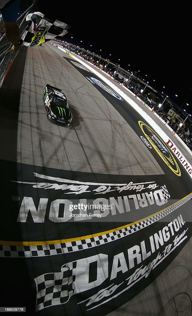 Kyle Busch, driver of the #54 Monster Energy Toyota, heads towards the star/finish line to take the checkered flag and win the NASCAR Nationwide Series VFW Sport Clips Help A Hero 200 at Darlington Raceway on May 10, 2013 in Darlington, South Carolina.