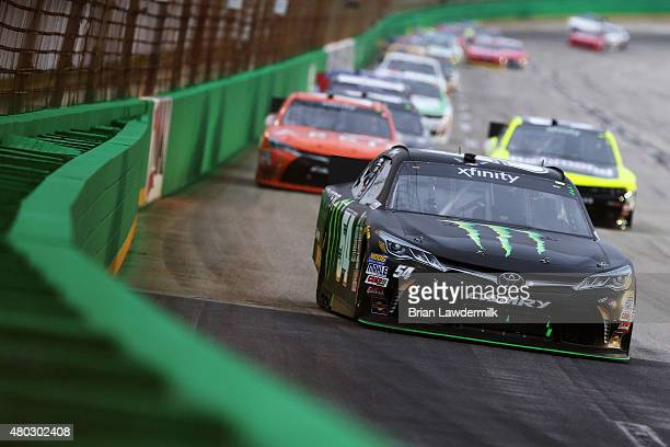 Kyle Busch, driver of the Monster Energy Toyota, leads a pack of cars during the NASCAR XFINITY Series Kentucky 300 at Kentucky Speedway on July 10,...