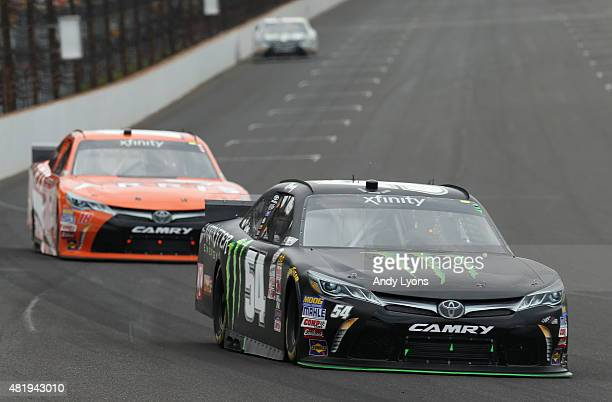 Kyle Busch, driver of the Monster Energy Toyota, leads Daniel Suarez, driver of the ARRIS Toyota, during the NASCAR XFINITY Series Lilly Diabetes 250...