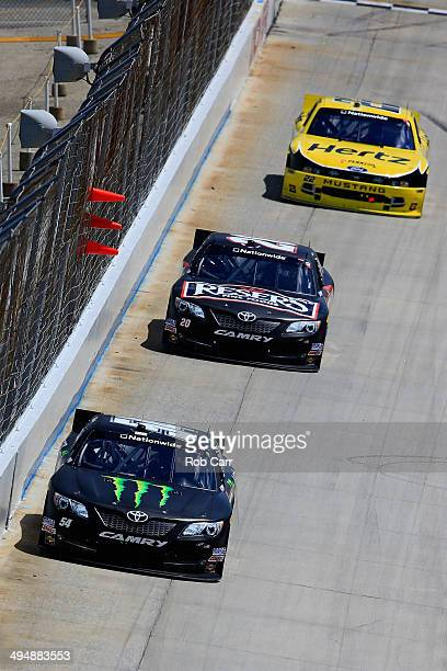 Kyle Busch driver of the Monster Energy Toyota leads Matt Kenseth driver of the Resers Toyota and Joey Logano driver of the Hertz Ford during the...