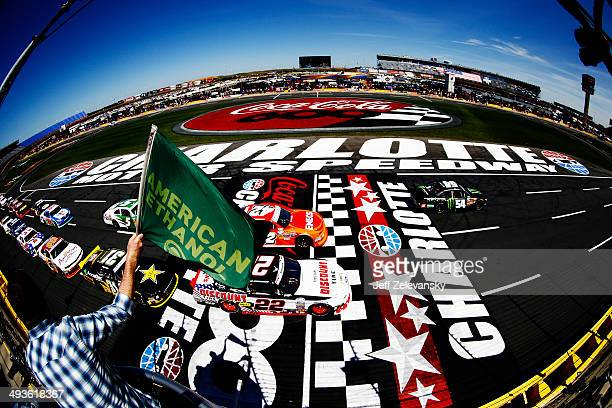 Kyle Busch driver of the Monster Energy Toyota leads the field past the green flag to start the NASCAR Nationwide Series History 300 at Charlotte...
