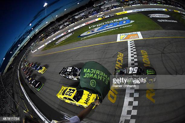 Kyle Busch driver of the Monster Energy Toyota leads the field through the green flag to start the NASCAR XFINITY Series Virginia529 College Savings...