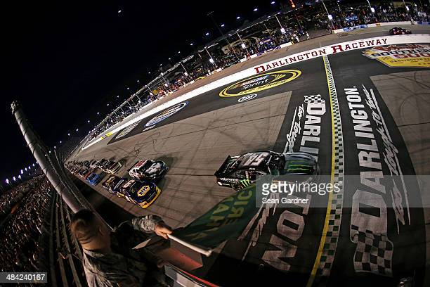 Kyle Busch driver of the Monster Energy Toyota leads the field to start the NASCAR Nationwide Series VFW Sport Clips Help A Hero 200 at Darlington...