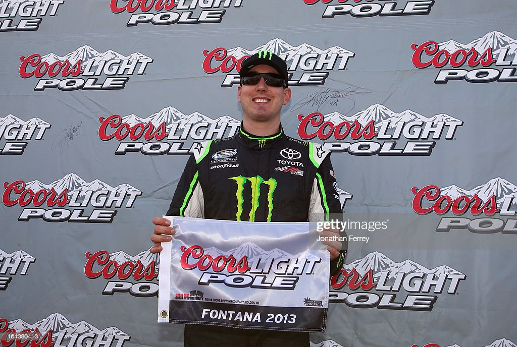 Kyle Busch, driver of the #54 Monster Energy Toyota, poses in Victory Lane after qualifying for the pole position in the NASCAR Nationwide Series Royal Purple 300 at Auto Club Speedway on March 23, 2013 in Fontana, California.