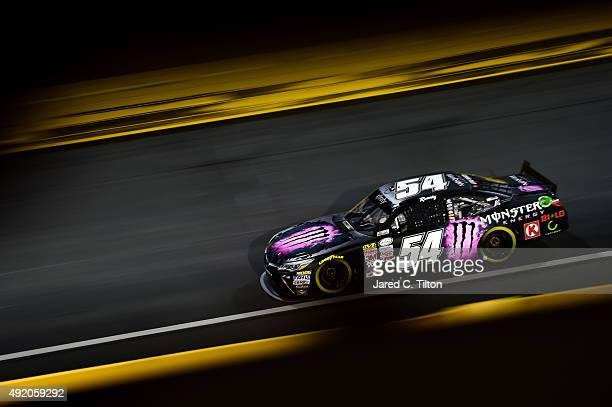 Kyle Busch, driver of the Monster Energy Toyota, races during the NASCAR XFINITY Series Drive for the Cure 300 at Charlotte Motor Speedway on October...