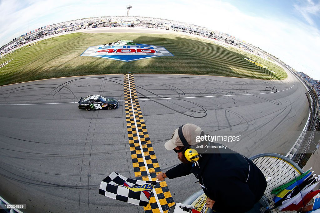 Kyle Busch, driver of the #54 Monster Energy Toyota, races to the checkered flag to win the NASCAR Nationwide Series Dollar General 300 Powered by Coca-Cola at Chicagoland Speedway on September 14, 2013 in Joliet, Illinois.