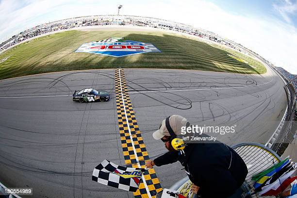 Kyle Busch, driver of the Monster Energy Toyota, races to the checkered flag to win the NASCAR Nationwide Series Dollar General 300 Powered by...
