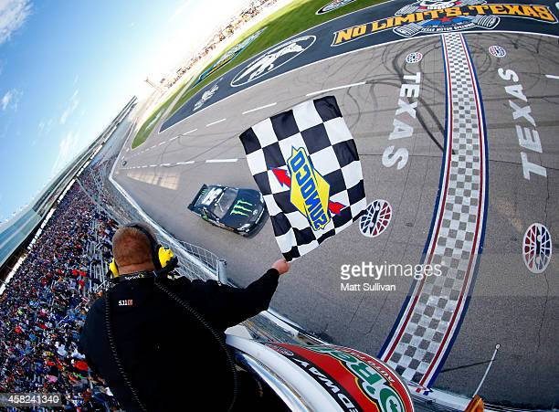 Kyle Busch, driver of the Monster Energy Toyota, races to the checkered flag to win the NASCAR Nationwide Series O'Reilly Auto Parts Challenge at...