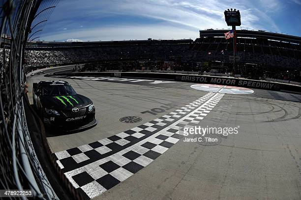 Kyle Busch driver of the Monster Energy Toyota takes the checkered flag to win the NASCAR Nationwide Series Drive To Stop Diabetes 300 at Bristol...