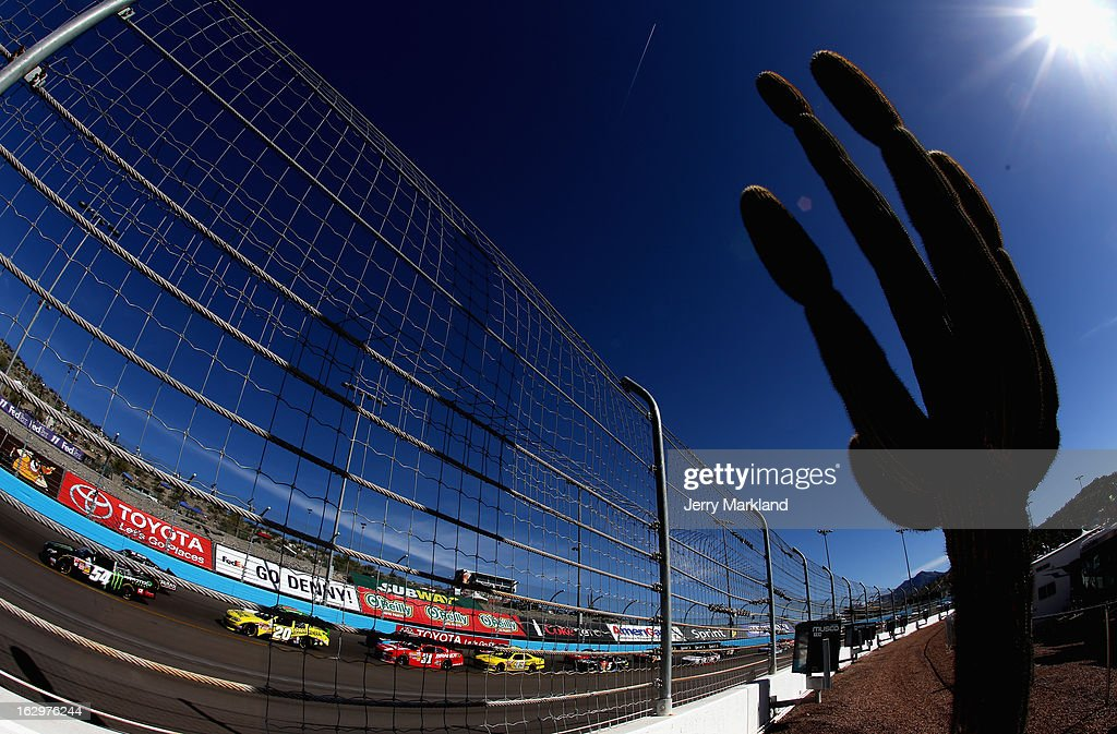 Kyle Busch, driver of the #54 Monster Toyota, drives ahead of Brian Vickers, driver of the #20 Dollar General Toyota, during the NASCAR Nationwide Series Dollar General 200 fueled by AmeriGas at Phoenix International Raceway on March 2, 2013 in Avondale, Arizona.