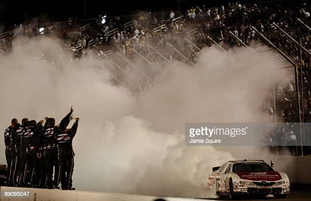 Kyle Busch driver of the New Balance Toyota performs a burnout after winning the NASCAR Nationwide Series MissouriIllinois Dodge Dealers 250 at...