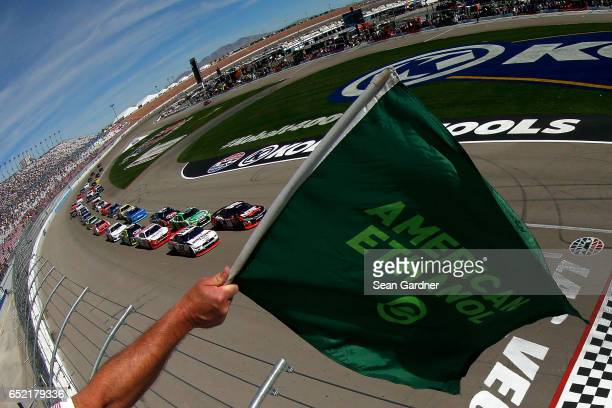 Kyle Busch driver of the NOS Energy Drink Rowdy Toyota and Brad Keselowski driver of the Discount Tire Ford lead the field to the green flag to start...