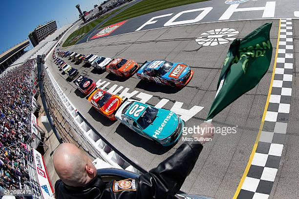 Kyle Busch, driver of the NOS Energy Drink Toyota, and Erik Jones, driver of the Hisense USA Toyota, lead the field to the green flag to start the...