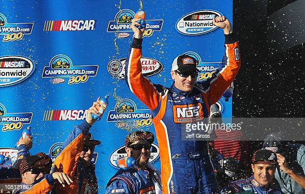 Kyle Busch driver of the NOS Energy Drink Toyota celebrates in victory lane after winnng the NASCAR Nationwide Series CampingWorldcom 300 on October...