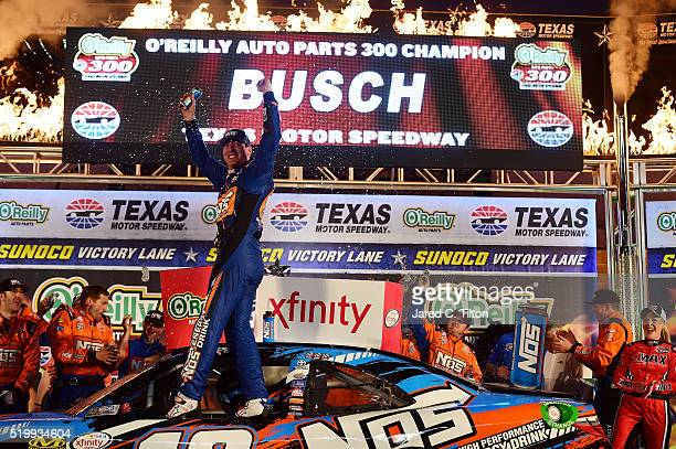 Kyle Busch, driver of the NOS Energy Drink Toyota, celebrates in Victory Lane after winning the NASCAR XFINITY Series O'Reilly Auto Parts 300 at...