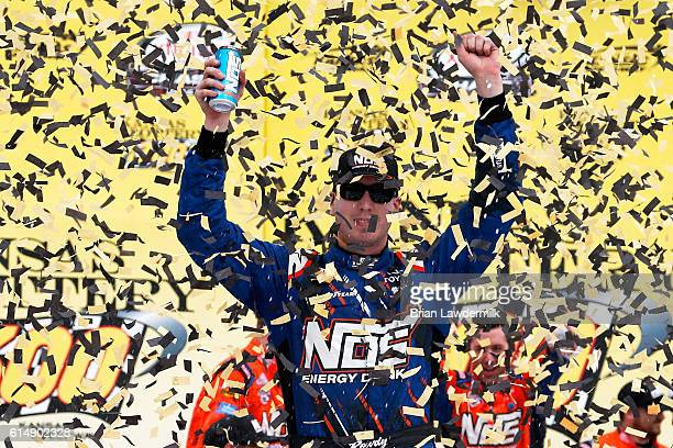 Kyle Busch, driver of the NOS Energy Drink Toyota, celebrates in Victory Lane after winning the NASCAR XFINITY Series Kansas Lottery 300 at Kansas...
