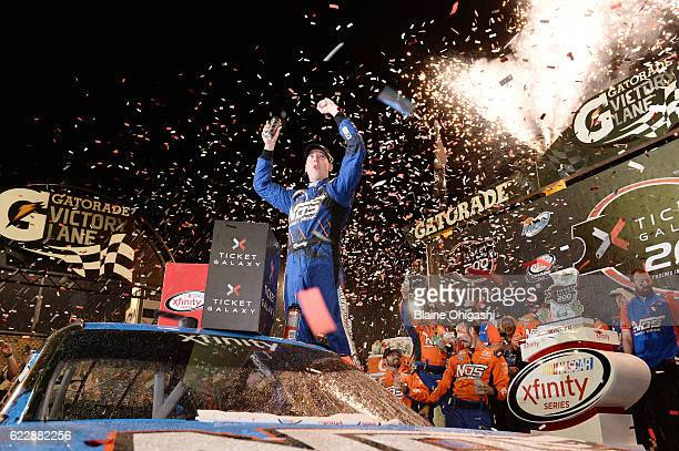 Kyle Busch driver of the NOS Energy Drink Toyota celebrates in Victory Lane after winning the NASCAR XFINITY Series Ticket Galaxy 200 at Phoenix...