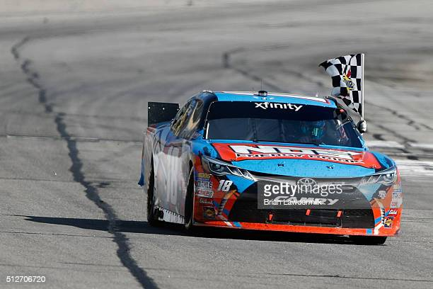 Kyle Busch driver of the NOS Energy Drink Toyota celebrates winning the NASCAR XFINITY Series Heads Up Georgia 250 at Atlanta Motor Speedway on...