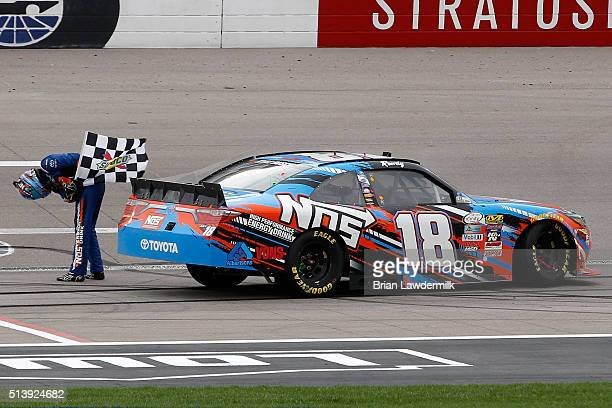 Kyle Busch, driver of the NOS Energy Drink Toyota, celebrates with the checkered flag after winning the NASCAR Xfinity Series Boyd Gaming 300 at Las...