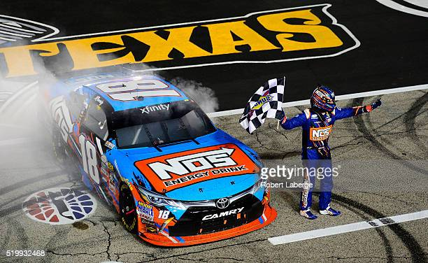Kyle Busch driver of the NOS Energy Drink Toyota celebrates with the checkered flag after winning the NASCAR XFINITY Series O'Reilly Auto Parts 300...