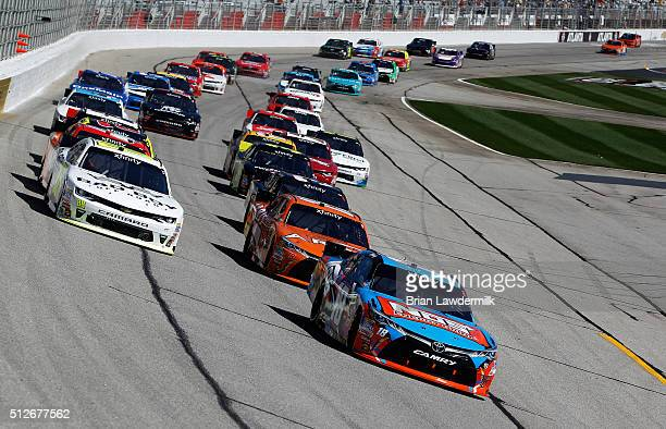 Kyle Busch driver of the NOS Energy Drink Toyota leads a pack of cars during the NASCAR XFINITY Series Heads Up Georgia 250 at Atlanta Motor Speedway...